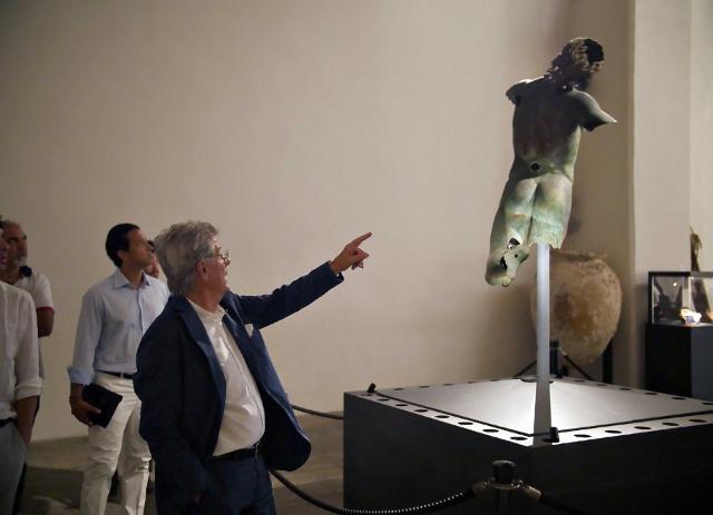 Adolfo Guzzini e il Satiro Danzante